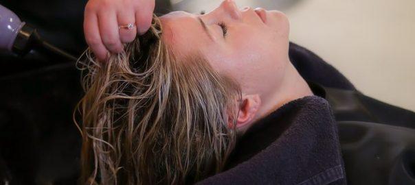 woman getting hr hair washed inside a salon