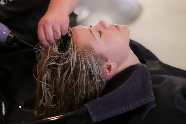 woman getting hr hair washed inside a salon